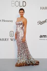 model dress irina shayk puts on a show in a dazzling metallic gown