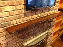 hand crafted live edge slab fireplace mantel by mad custom wood