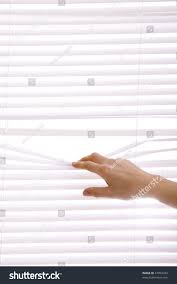 hands apart on window blinds stock photo 37954333 shutterstock
