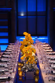 Party Tables Linens - long banquet tables are covered in gray linens and punctuated with