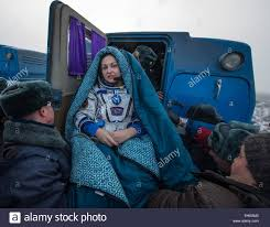 iss expedition 42 cosmonaut elena serova wrapped in a blanket is