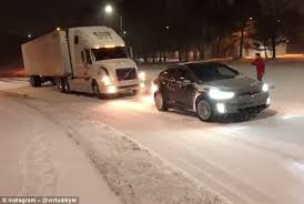 tesla model x is able to tow a 35 000lb semi truck daily mail online