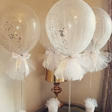 tulle balloons with silver confetti for a holy communion so