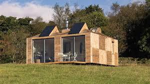 these modular pod homes balance on stilts so plants can grow