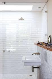 white bathroom tile ideas white tiles and skylight banheiros e lavabos white