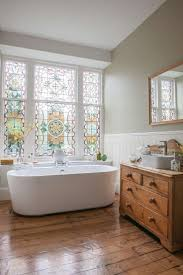 25 best glass bathroom ideas on pinterest modern bathrooms restored stained glass window in the bathroom beautiful bathrooms