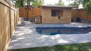 a backyard backyard landscaping ideas with interlocking pool deck markstone