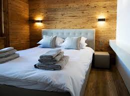 wooden wall bedroom interior designs simple wood walls in the bedroom with grey bed and
