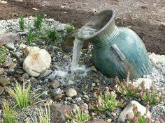 Small Backyard Water Features by Disappearing Streams Are A Great Touch In Smaller Backyards
