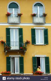man looking out window of hotel in bellagio on lake como in
