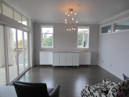 chandelier on simple ceiling grey hardwood floors