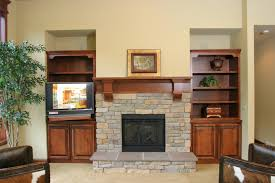Fireplace Mantels With Bookcases Interior Stacked Stone Fireplace Surround Plus Bookcases And