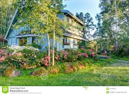 big farm house big farmhouse with beautiful flowerbed stock photo image 37436610