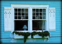 beach house shutters incredible 2 tropical beach cottage shutters