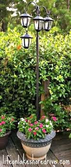 wilson and fisher solar lighted bird bath solar light post with planter solar power outdoor l post outdoor