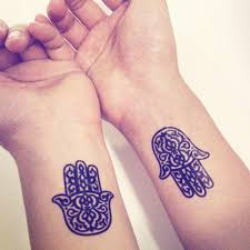 simple black hamsa tattoo on wrist
