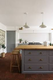 best 25 galley kitchen island ideas on pinterest kitchen island deep pan drawers provide plenty of storage in this kitchen island finished with brass hardware