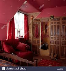 reclamation wooden paneling in deep pink cottage bedroom with pink