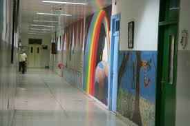 beit emmett mural painting one afternoon we joined in and helped paint murals on the wall of the kindergarten classroom at the princess basma center for disabled children on the mt of