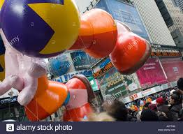 clown balloon dwarfs the crowd in the 2005 macy s thanksgiving day