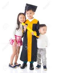 toddler cap and gown asian school kid graduate in graduation gown and cap taking