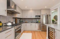 Light Gray Kitchen Walls Light Gray Kitchen Cabinets Hanging Lamps Modern Kitchen Faucet