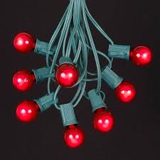satin g30 globe outdoor string light set on green wire