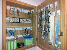 unused medicine cabinet turned into jewelry box for the home