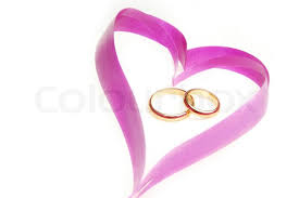 wedding ribbon up photo of the ribbon heart with wedding rings stock photo