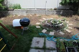 back yard edible landscaping raised beds herb spiral trellises