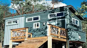 rustic modern log cabin tiny home with rooftop deck small house
