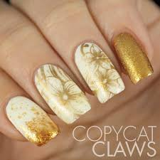 copycat claws sunday stamping white and gold nails nail