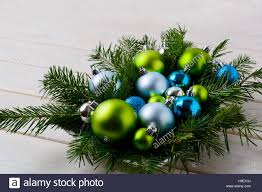 table centerpiece with silver blue and green ornaments
