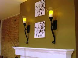 candle wall sconces over fireplace mantel installed in the walls
