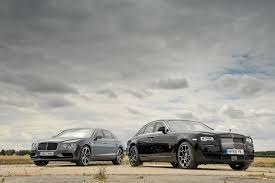 luxury cars rolls royce twin test bentley flying spur vs rolls royce ghost parkers