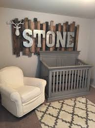 rustic wood pallet sign with galvanized metal letters above the