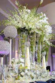 wedding flowers ta candle holders and vases of flowers beautiful