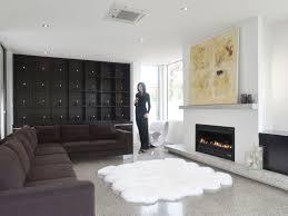 Rug For Living Room by Flooring Elegant White Sheepskin Rug On Cozy Dark Pergo Flooring