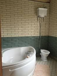 trojan laguna 1350 x 1350mm corner bath tub with panel