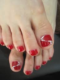 red pedi with glitter and rhinestone accent nail hair and beauty