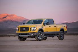nissan titan vs dodge ram revealed 2016 nissan titan xd rated to tow 12 314 pounds