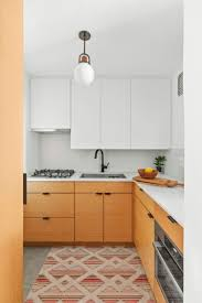 oak kitchen cabinets a comeback two tone cabinets ideas and inspiration for your renovation