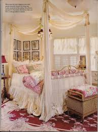 dreaming of beautiful beds i love the vintage fashion photos on the wall and the chandelier hung nice and low over the bed where you can really see and appreciate it