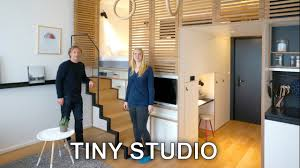 tiny studio apartment sleeping loft and moving staircase zoku