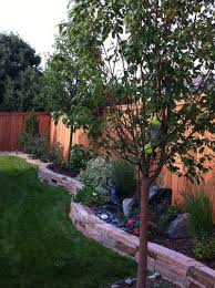 Backyard Landscaping Ideas For Small Yards What A Difference The Stone Wall Makes Landscaping For Small