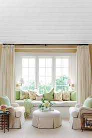window treatment ideas for living room bay window seat with pillows panels and chair slipcover window