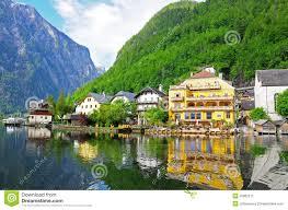 reflection of village in hallstatt austria stock image image