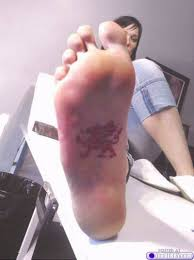 black heart tattoo on sole of foot