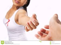 woman giving hand for aids or breast cancer cause stock images