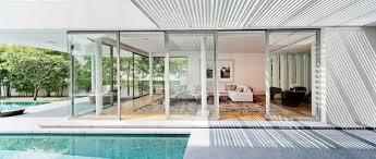 impressive glass box house by beige design